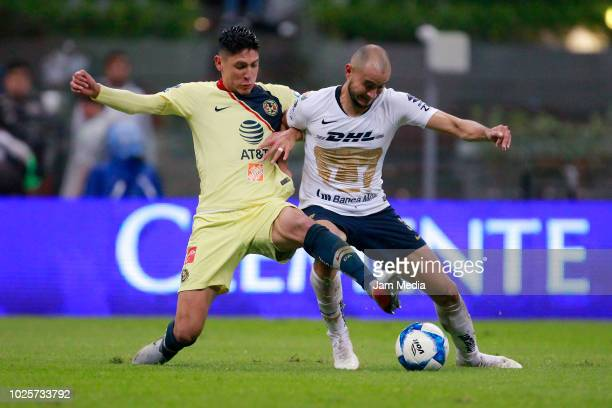 Edson Alvarez of America fights for the ball with Carlos Gonzalez of Pumas during the 7th round match between America and Pumas UNAM as part of the...