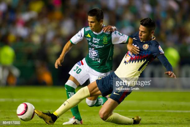Edson Alvarez of America fights for the ball with Jose Rodriguez of Leon during the 11th round match between Leon and America as part of the Torneo...