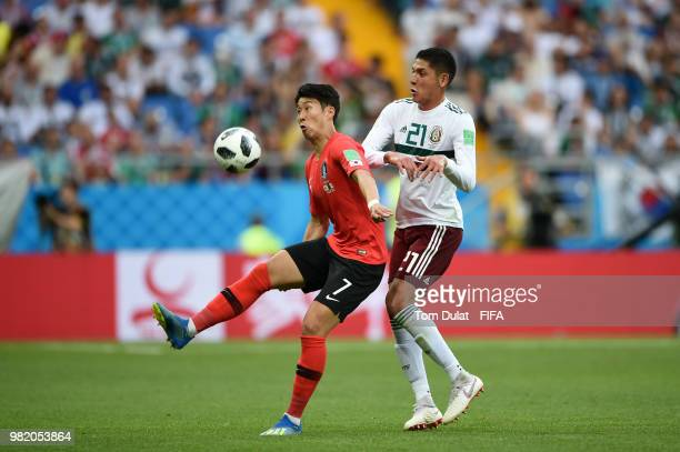 Edson Alvarez of Mexico battles for possession with Son HeungMin of Korea Republic during the 2018 FIFA World Cup Russia group F match between Korea...