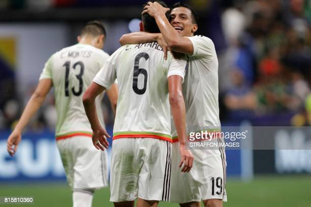 Edson Alvarez of Mexico celebrates with Angel Sepulveda after scoring the second goal of his team during a Group C match between Mexico and Curacao...