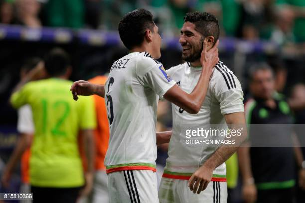 Edson Alvarez of Mexico celebrates with Jair Pereira after scoring the second goal of his team during a Group C match between Mexico and Curacao as...