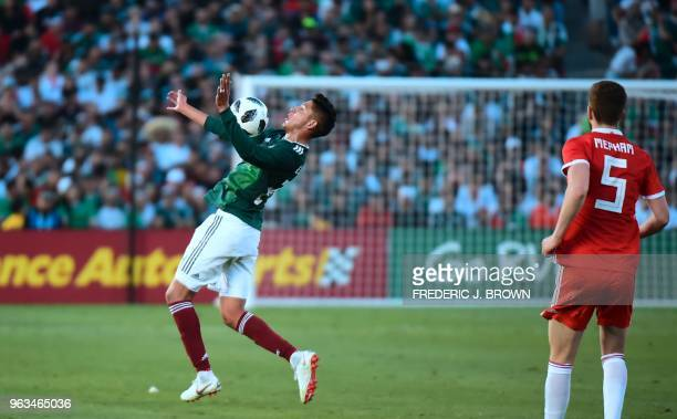 Edson Alvarez of Mexico controls the ball on his chest as Chris Mepham of Wales watches during their international football friendly at the Rose Bowl...