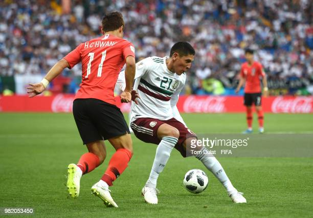 Edson Alvarez of Mexico is tackled by Hwang Heechan of Korea Republic during the 2018 FIFA World Cup Russia group F match between Korea Republic and...