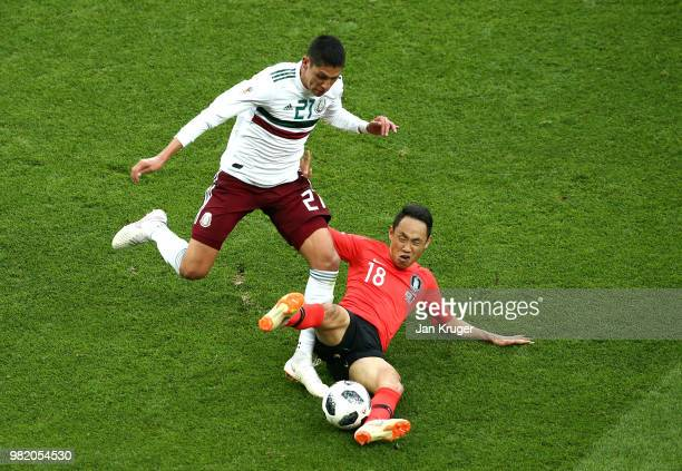 Edson Alvarez of Mexico is tackled by Moon Seon-Min of Korea Republic during the 2018 FIFA World Cup Russia group F match between Korea Republic and...