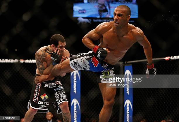 Edson Barboza kicks Rafaello Oliveira in their lightweight fight during the UFC 162 event inside the MGM Grand Garden Arena on July 6 2013 in Las...