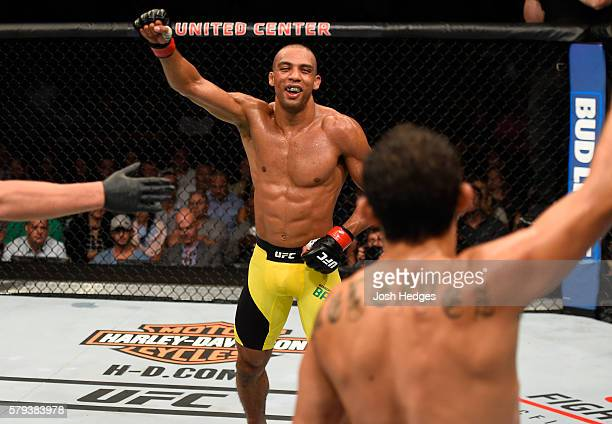 Edson Barboza of Brazil and Gilbert Melendez celebrate after finishing three rounds in their lightweight bout during the UFC Fight Night event at the...