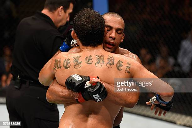 Edson Barboza of Brazil and Gilbert Melendez embrace after finishing three rounds in their lightweight bout during the UFC Fight Night event at the...