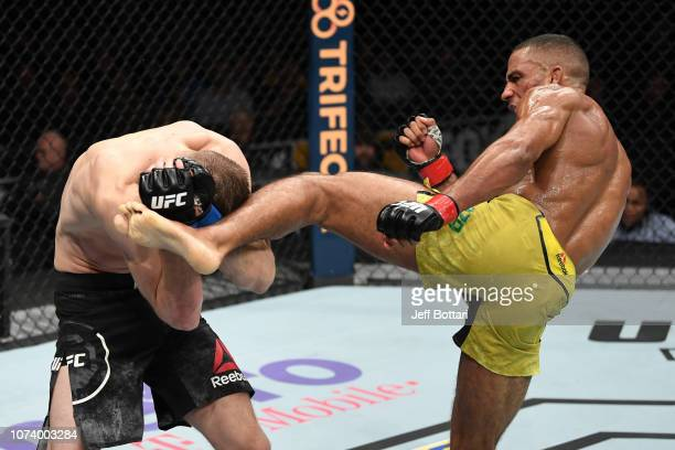 Edson Barboza of Brazil kicks Dan Hooker of New Zealand in their lightweight bout during the UFC Fight Night event at Fiserv Forum on December 15...