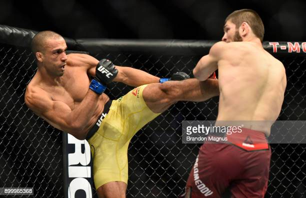 Edson Barboza of Brazil kicks Khabib Nurmagomedov of Russia in their lightweight bout during the UFC 219 event inside TMobile Arena on December 30...