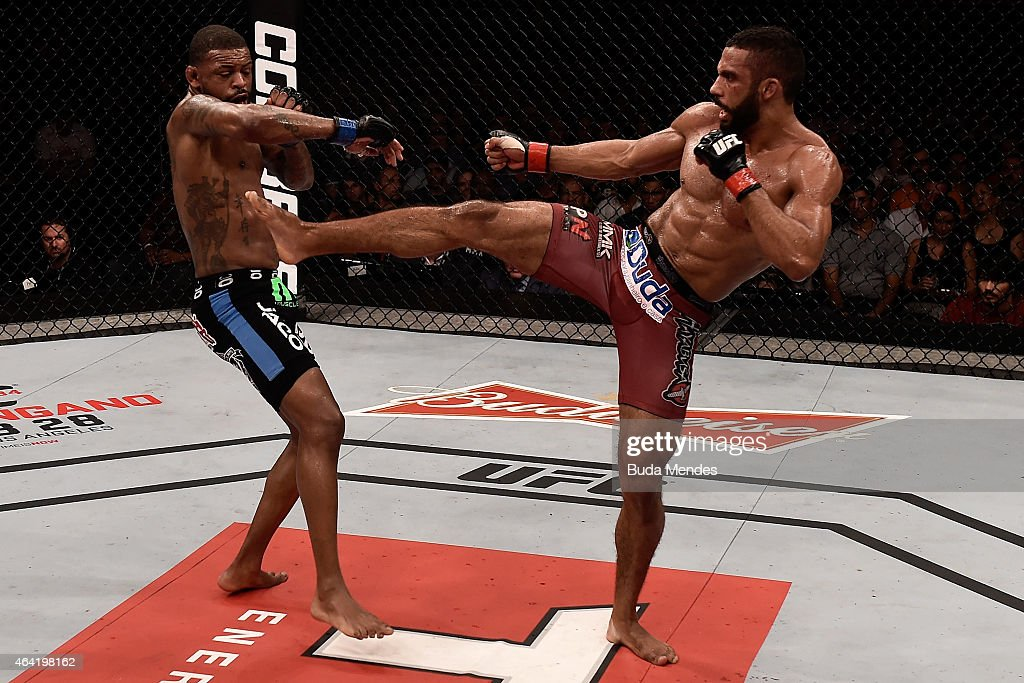 Edson Barboza of Brazil kicks Michael Johnson of the United States in their lightweight bout during the UFC Fight Night at Gigantinho Gymnasium on February 22, 2015 in Porto Alegre, Brazil.