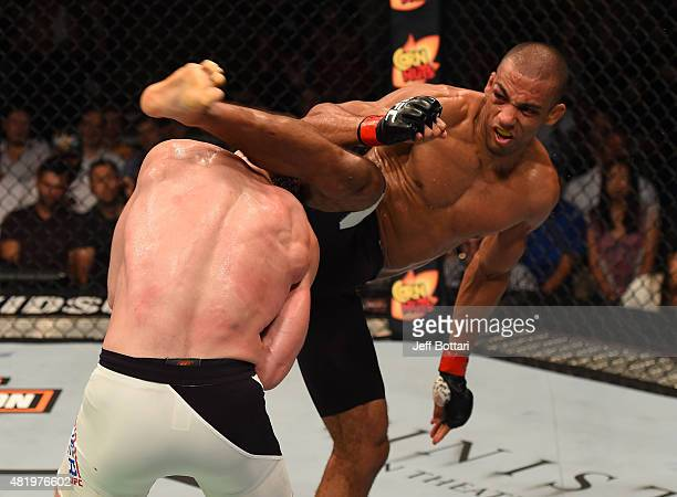 Edson Barboza of Brazil kicks Paul Felder in their lightweight bout during the UFC event at the United Center on July 25, 2015 in Chicago, Illinois.