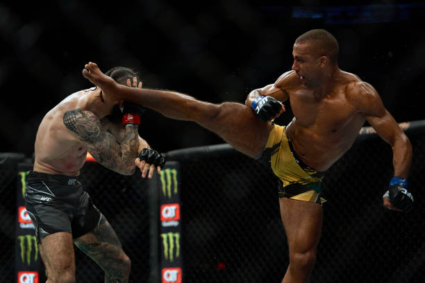 Edson Barboza of Brazil kicks Shane Burgos in their featherweight bout during the UFC 262 event at Toyota Center on May 15, 2021 in Houston, Texas.