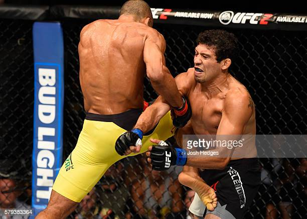 Edson Barboza of Brazil lands a flying knee to the body of Gilbert Melendez in their lightweight bout during the UFC Fight Night event at the United...