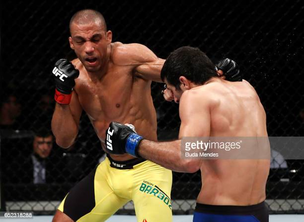 Edson Barboza of Brazil punches Beneil Dariush of Iran in their lightweight bout during the UFC Fight Night event at CFO Centro de Formaco Olimpica...