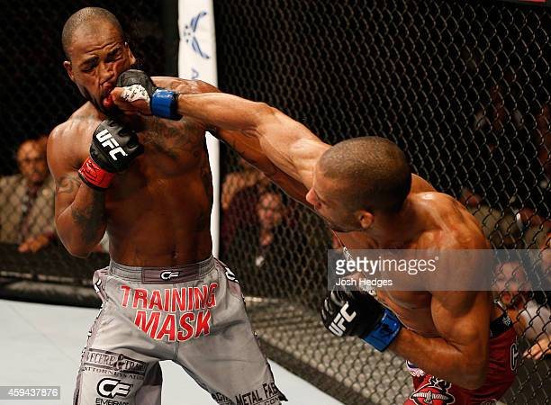 Edson Barboza of Brazil punches Bobby Green in their lightweight bout during the UFC Fight Night event at The Frank Erwin Center on November 22 2014...
