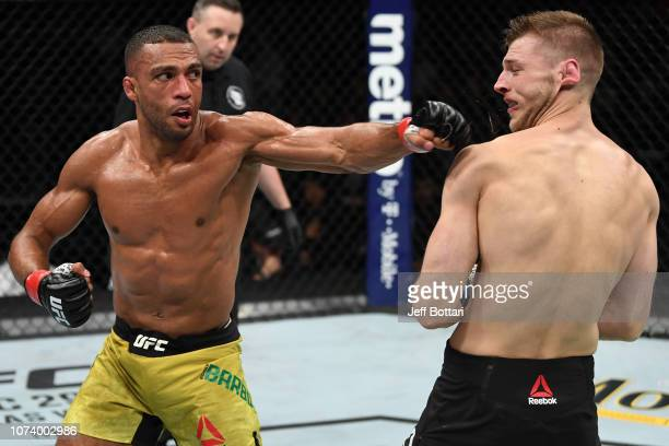 Edson Barboza of Brazil punches Dan Hooker of New Zealand in their lightweight bout during the UFC Fight Night event at Fiserv Forum on December 15,...
