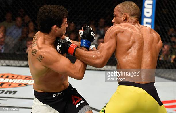 Edson Barboza of Brazil punches Gilbert Melendez in their lightweight bout during the UFC Fight Night event at the United Center on July 23 2016 in...