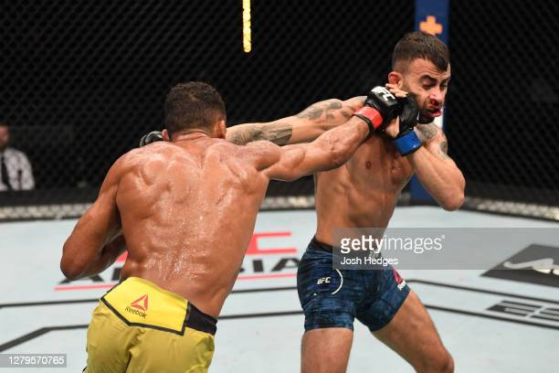 Edson Barboza of Brazil punches Makwan Amirkhani of Finland in their featherweight bout during the UFC Fight Night event inside Flash Forum on UFC...
