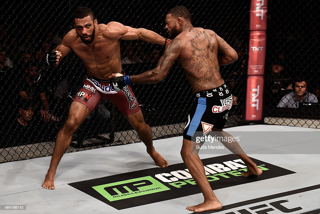 Edson Barboza of Brazil punches Michael Johnson of the United States in their lightweight bout during the UFC Fight Night at Gigantinho Gymnasium on February 22, 2015 in Porto Alegre, Brazil.