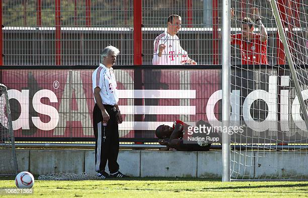 Edson Braafheid of Bayern Muenchen and assistant coach Marcel Bout attend Braafheid's first training session following suspenion at Bayern's training...