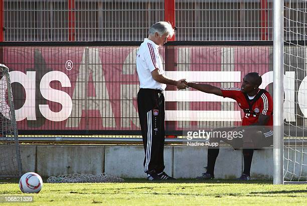Edson Braafheid of Bayern Muenchen shakes hands with assistant coach Marcel Bout during his first training session following suspenion at Bayern's...