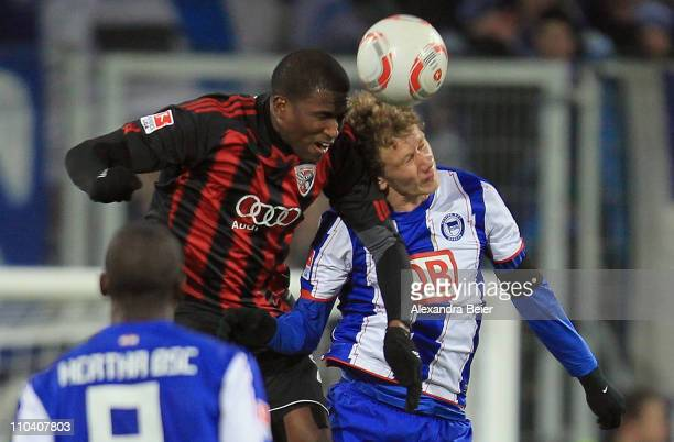 Edson Buddle of Ingolstadt heads for the ball with Fabian Lustenberger of Hertha BSC during the second Bundesliga match between FC Ingolstadt and...