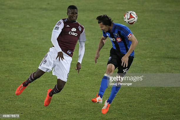 Edson Buddle of the Colorado Rapids and Heath Pearce of the Montreal Impact vie for the ball at Dick's Sporting Goods Park on May 24, 2014 in...