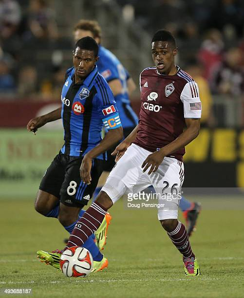 Edson Buddle of the Colorado Rapids controls the ball against Patrice Bernier of the Montreal Impact at Dick's Sporting Goods Park on May 24 2014 in...