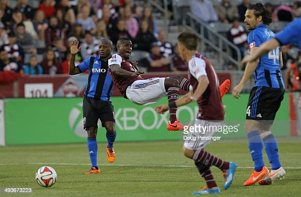 Edson Buddle of the Colorado Rapids is fouled by Sanna Nyassi of the Montreal Impact in the penalty box in the third minute at Dick's Sporting Goods...