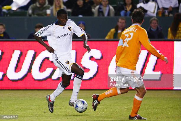 Edson Buddle of the Los Angeles Galaxy attacks the defense of the Houston Dynamo during their MLS Western Conference Championship game at The Home...