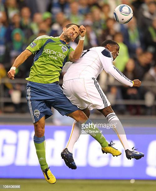 Edson Buddle of the Los Angeles Galaxy battles Patrick Ianni of the Seattle Sounders FC during the 1st leg playoff game at Qwest Field on October 31...