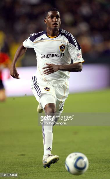 Edson Buddle of the Los Angeles Galaxy paces the ball on the attack against the New England Revolution during their MLS match at the Home Depot...
