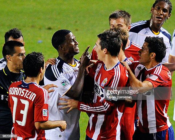 Edson Buddle of the Los Angeles Galaxy points a finger at Sacha Kljestan of Chivas USA as they argue during the first half of the MLS soccer match on...