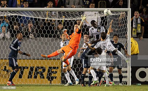 Edson Buddle of the Los Angeles Galaxy tries for the header as goalkeeper Brad Knighton of the Vancouver Whitecaps defends his net during the MLS...