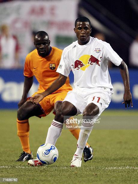 Edson Buddle of the New York Red Bulls passes in front of Lilian Thuram of FC Barcelona during their International Friendly Match on August 12 2006...