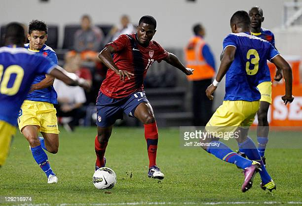 Edson Buddle of the US dribbles by Edison Mendez of Ecuador during their match at Red Bull Arena on October 11 2011 in Harrison New Jersey