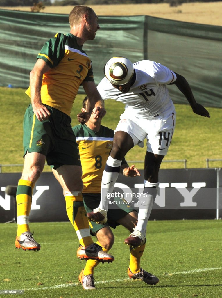 Edson Buddle (R) of the US heads past Australia's Craig Moore to score their second goal during a friendly football match at Ruimsig Stadium in Roodepoort, Johannesburg on June 5, 2010, prior to the FIFA 2010 world cup.