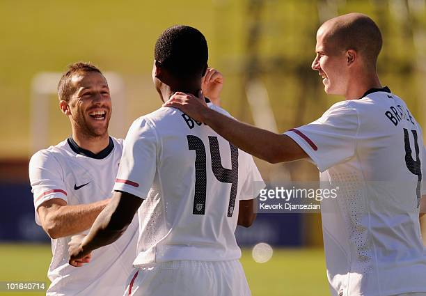 Edson Buddle of USA is congratulated by Steve Cherundolo and Michael Bradley after scoring a goal against Australia during first half of the 2010...