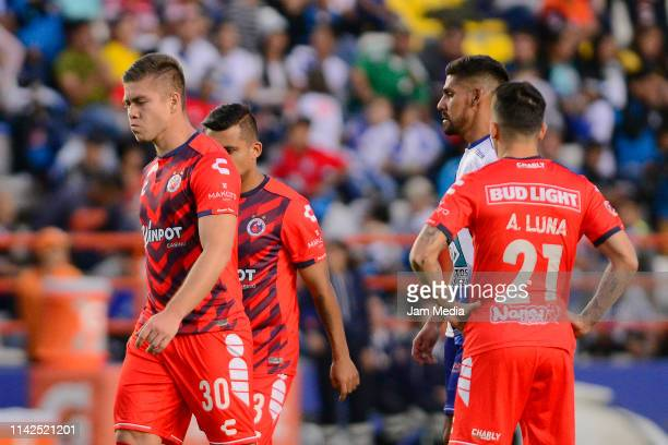 Edson Garcia, Carlos Gutierrez and Adrian Luna of Veracruz lament during the 14th round match between Pachuca and Veracruz as part of the Torneo...