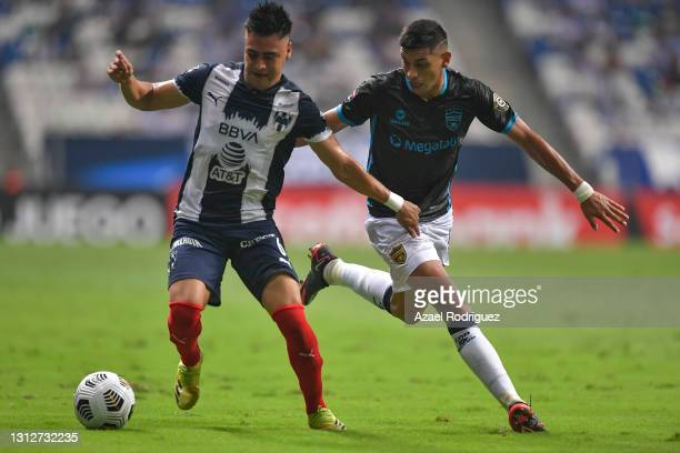 Edson Gutiérrez of Monterrey fights for the ball with Lucas González of Atlético Pantoja during a second leg match between Monterrey and Atletico...
