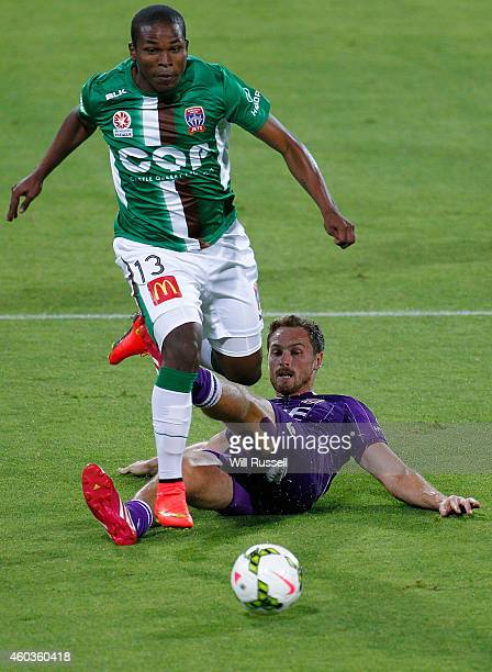 Edson Montano of the Jets avoids a tackle from Rostyn Griffiths of the Glory during the round 11 ALeague match between Perth Glory and Newcastle Jets...