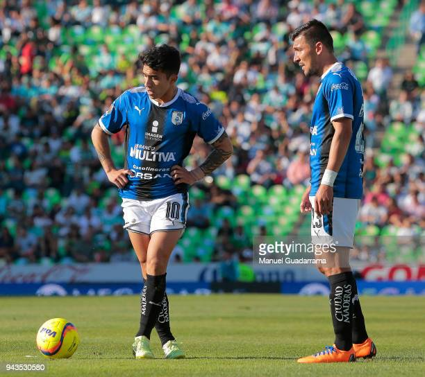 Edson Puch and Edgar Benitez of Queretaro look on prior a free kick during the 14th round match between Santos Laguna and Querataro as part of the...