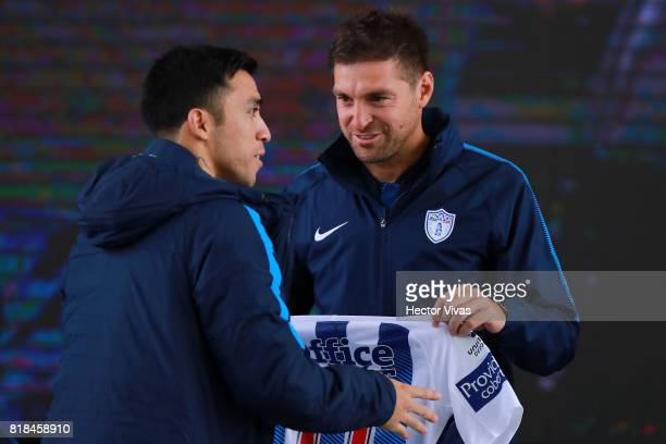 Edson Puch of Pachuca receives his new jersey from Diego Alonso coach of Pachuca during a press conference to unveil Pachuca's new signings at...