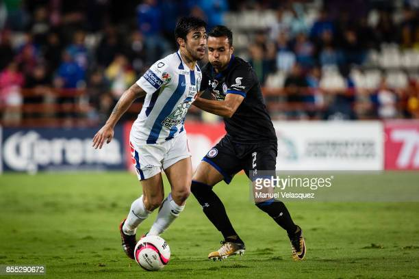 Edson Puch of Pachuca struggles for the ball with Omar Mendoza of Cruz Azul during the 11th round match between Pachuca and Cruz Azul as part of the...