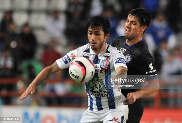 Edson Puch of Pachuca vies for the ball with Francisco Silva of Cruz Azul during their Mexican Apertura tournament football match at the Hidalgo...