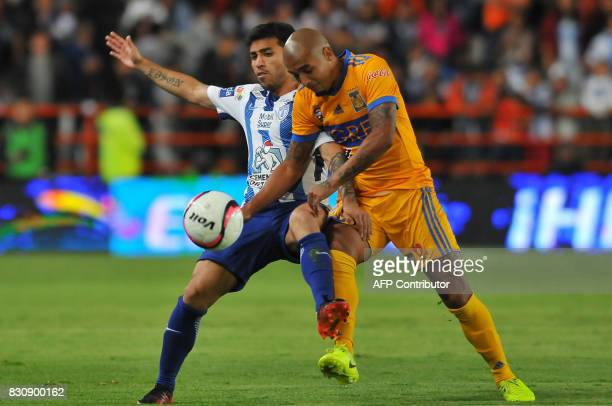 Edson Puch of Pachuca vies for the ball with Luis Rodriguez of Tigres during their Mexican Apertura 2017 Tournament football match at Hidalgo stadium...