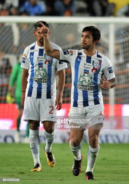 Edson Puch of Pachuca vies for the ball with Omar Mendoza of Cruz Azul during their Mexican Apertura tournament football match at the Hidalgo stadium...