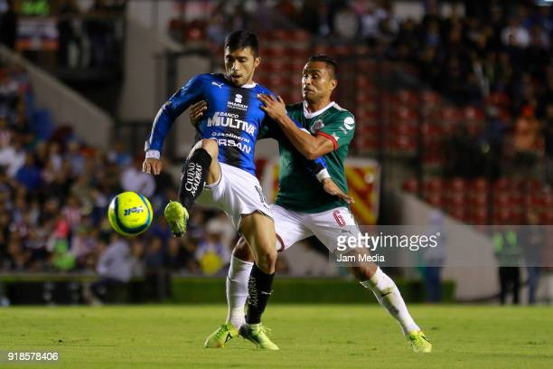 Edson Puch of Queretaro and Edwin Hernandez of Chivas fight for the ball during the 7th round match between Queretaro and Chivas as part of the...