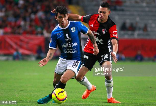 Edson Puch of Queretaro and Ismael Govea of Atlas fight for the ball during the 15th round match between Atlas and Queretaro at Estadio Jalisco on...