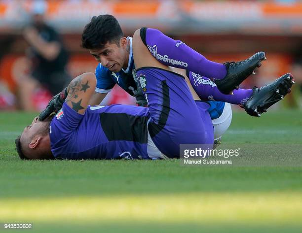 Edson Puch of Queretaro and Jonathan Orozco goalkeeper of Santos react during the 14th round match between Santos Laguna and Querataro as part of the...